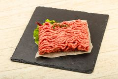 Raw minced beef meat. With thyme and hot pepper Royalty Free Stock Photos