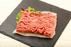 Raw minced beef meat. With thyme and hot pepper Royalty Free Stock Images