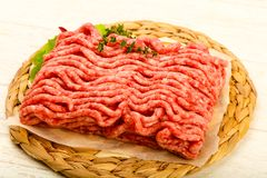 Raw minced beef meat. With thyme and hot pepper Stock Images