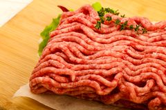 Raw minced beef meat. With thyme and hot pepper Royalty Free Stock Image