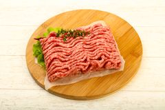 Raw minced beef meat. With thyme and hot pepper Stock Photography