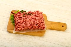 Raw minced beef meat. With thyme and hot pepper Royalty Free Stock Photography