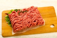 Raw minced beef meat. With thyme and hot pepper Stock Photo