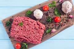 Raw minced beef meat with spices and herbs. Food background stock image