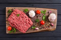Raw minced beef meat with spices and herbs. Food background royalty free stock images
