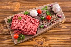 Raw minced beef meat with spices and herbs. Food background royalty free stock image