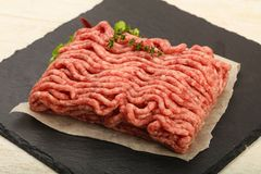 Raw minced beef meat. With thyme and hot pepper Stock Photos