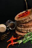 Raw Minced burger Meat with Herb and Spice Prepared for Grilling with rosemary, hot red chili, black pepper. On black wooden table royalty free stock photography