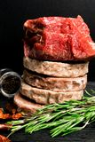 Raw Minced burger Meat with Herb and Spice Prepared for Grilling with rosemary, hot red chili, black pepper and piece of meat. Raw Minced burger Meat with Herb royalty free stock photo