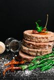 Raw Minced burger Meat with Herb, Spice, Salt Prepared for Grilling with rosemary, hot red chili, black pepper. On black wooden table stock photography