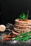 Raw Minced burger Meat with Herb, Spice, Salt Prepared for Grilling with rosemary, hot red chili, black pepper. On black wooden table royalty free stock image