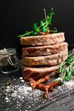 Raw Minced burger Meat with Herb, Spice, Salt Prepared for Grilling with rosemary, hot red chili, black pepper. On black wooden table stock photo