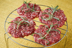 Raw minced hamburger meat with herb and spice Stock Image