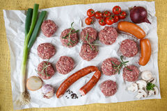 Raw minced hamburger meat with herb and spice Stock Photos
