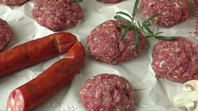 Raw minced hamburger meat with herb and spice stock video footage