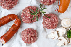 Raw minced hamburger meat and sausage with herb and spice Stock Images