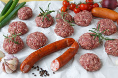 Raw minced hamburger meat and sausage with herb and spice Royalty Free Stock Images