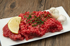 Raw minced meat. On wooden table Royalty Free Stock Images