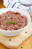 Raw minced meat. In white bowl Stock Images