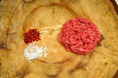 Raw minced meat. Raw minced steack on wooden chopping board Royalty Free Stock Images