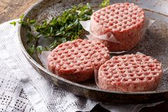 Raw minced meat burgers stock photography