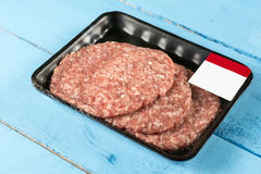 Raw minced meat burgers in the market package with price tag Stock Photo
