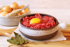 Raw minced meat with egg and onions Stock Images