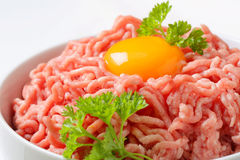 Raw minced meat and egg yolk. Raw minced meat and yolk in a bowl Royalty Free Stock Photo