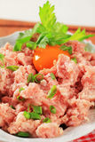 Raw minced meat. And egg yolk in a bowl Royalty Free Stock Photos