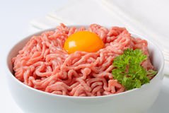 Raw minced meat and egg yolk. Raw minced meat and yolk in a bowl Stock Photography