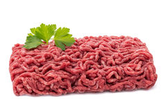 Raw minced meat with garnish. On a white isolated background Stock Photography