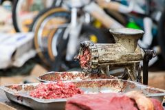 Raw minced meat and a grinder with flies outdoors in Madagascar. Raw minced meat and a grinder with flies outdoors in Toliara, Madagascar royalty free stock photos