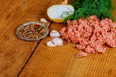 Raw Minced meat with Ground beef. Minced meat close up. Raw meat stuffing with ground beef with spices pepper garlic salt Stock Photo