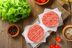 Raw minced meat for home made grill burgers cooking with spaces and herbs. Raw minced meat for home made grill burgers cooking with spaces and herbs royalty free stock images
