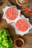 Raw minced meat for home made grill burgers cooking with spaces. And herbs stock images