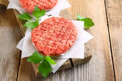 Raw minced meat for home made grill burgers cooking with spaces. And herbs royalty free stock images