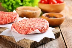 Raw minced meat for home made grill burgers cooking with spaces and herbs. Raw minced meat for home made grill burgers cooking with spaces and herbs royalty free stock photo