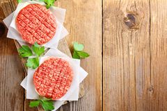 Raw minced meat for home made grill burgers cooking with spaces and herbs. Raw minced meat for home made grill burgers cooking with spaces and herbs stock image