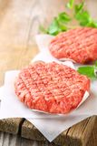 Raw minced meat for home made grill burgers cooking with spaces and herbs. Raw minced meat for home made grill burgers cooking with spaces and herbs stock photos