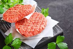Raw minced meat for home made grill burgers cooking with spaces and herbs. Raw minced meat for home made grill burgers cooking with spaces and herbs royalty free stock photography