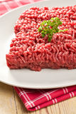 Raw minced meat on kitchen table Stock Photo