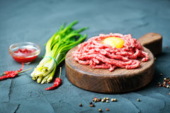Raw minced meat. On plate and on a table Stock Photography