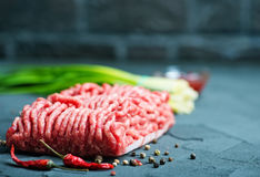 Raw minced meat. On plate and on a table Stock Photo