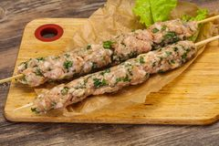 Raw minced pork skewer kebab for grill. Raw pork skewer kebab ready for grill stock photography