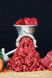 Raw Mincer with fresh minced beef meat Royalty Free Stock Photography