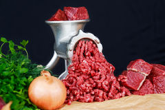 Raw Mincer with fresh minced beef meat Royalty Free Stock Photos