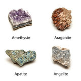 Raw minerals. 4 mineral stones  on white background:amethyst aragonite, apatite, angelite Stock Images