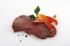 Raw minute steak, parsley and pepper corns Royalty Free Stock Images