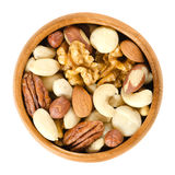 Raw mixed nuts in wooden bowl over white Royalty Free Stock Photos