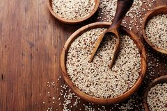 Raw mixed quinoa in bowl on wooden kitchen table top view. Healthy and diet superfood product.  royalty free stock photos